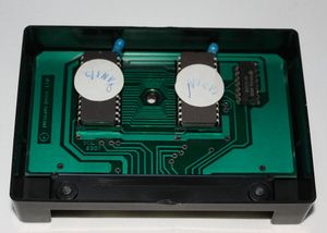 Open Cosmic Invaders cartridge exposing the electronics